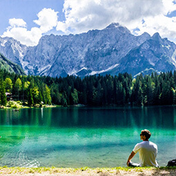 lake mountains apes man sitting solo view landscape street photography travel UGC content