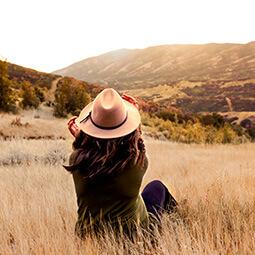 mum daughter looking horizon portrait hat yellow mountain hills distance UGC content